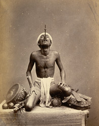 Juggler performing the sword-swallowing trick, Madras